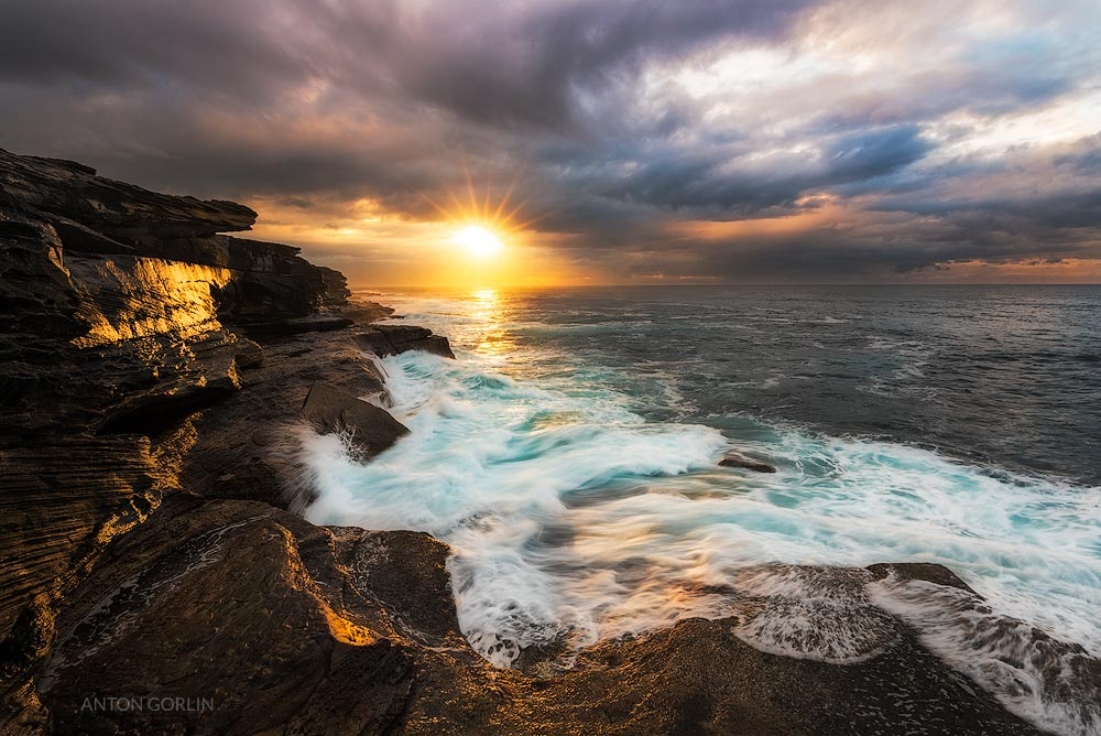 Maroubra Beach sea cliffs sunrise with the Sun