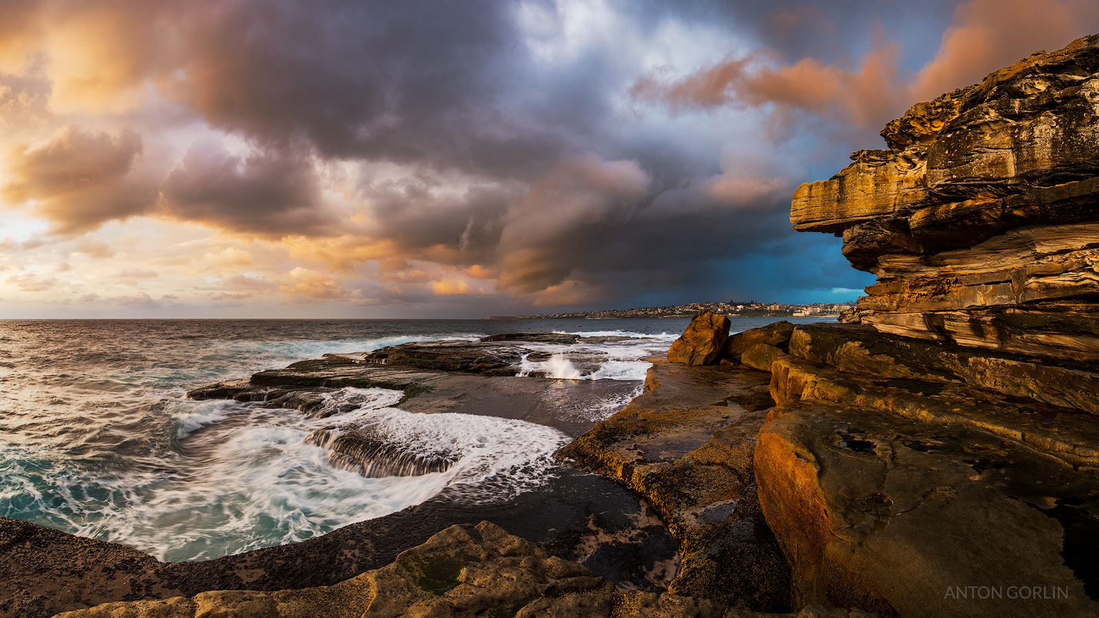 Clovelly beach stormy sunrise panorama
